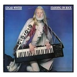 LP EDGAR WINTER STANDING ON ROCK